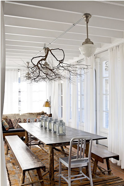 Tree branches are above the dining table