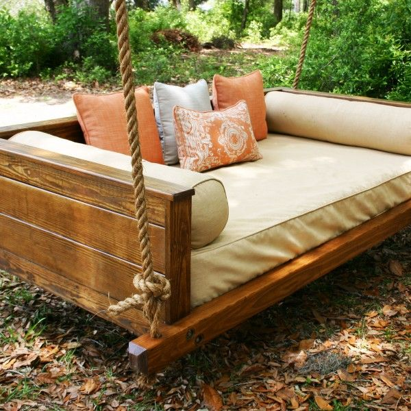 Swing bench with cushions on it