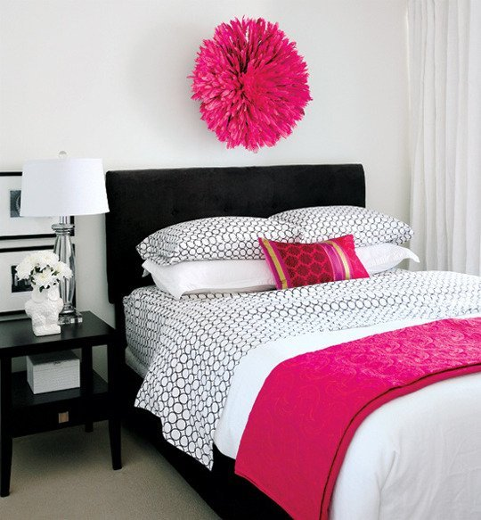 Bedroom with a pink pompom art