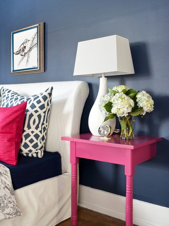 Bedroom with a pink side table