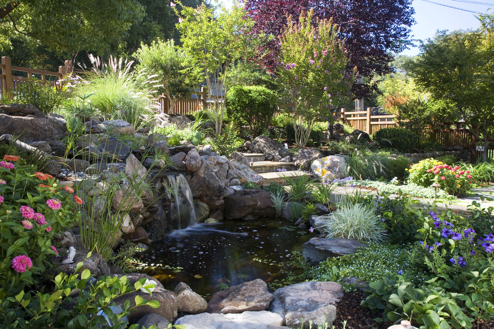 Beautiful garden pond waterfalls design ideas for Backyard pond ideas with waterfall
