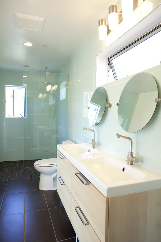 Bathroom with blue colored subway tiles