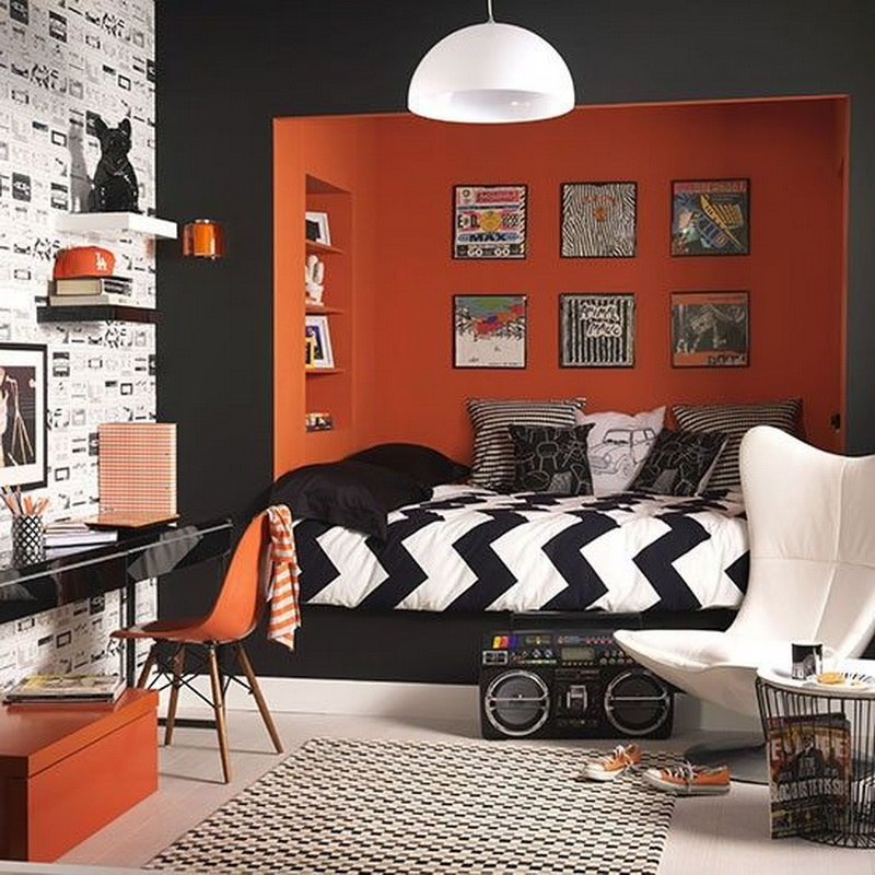 orange walls near the bed