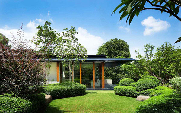 House exterior surrounded with greenery