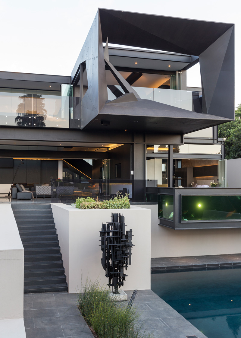 Black steps leading to the outdoor living room