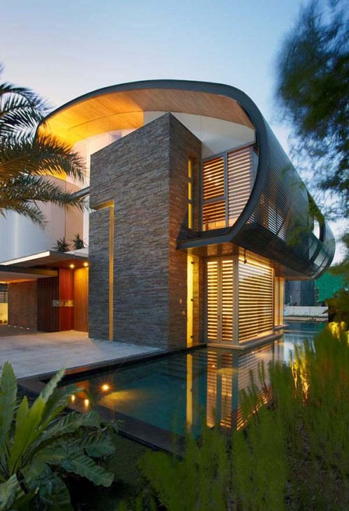 Modern house exterior with a swimming pool