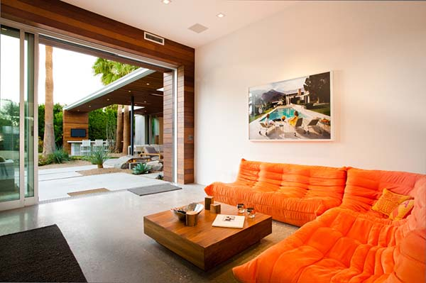 Guest house with an orange floor level sofa