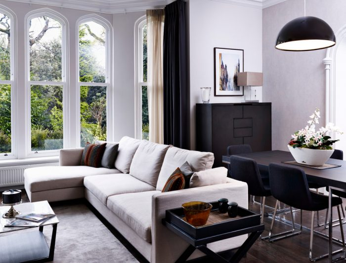 Room with arched windows and sectional sofa