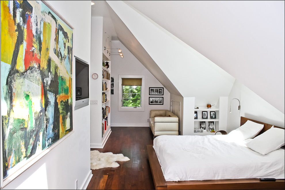 white bedroom with wall art
