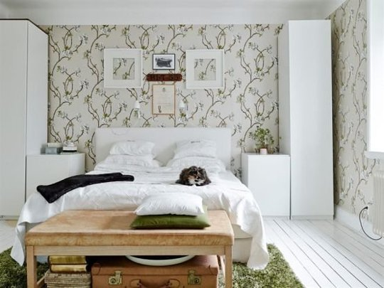 Bedroom with cabinets on both sides of the bed