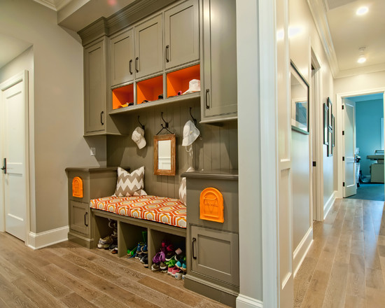 Mudroom with orange colored open shelves